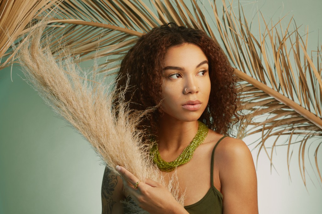 Umber & Peridot, dreamy jewelry look book by Oakland photographer Ella Sophie. Model with necklace and dried palms