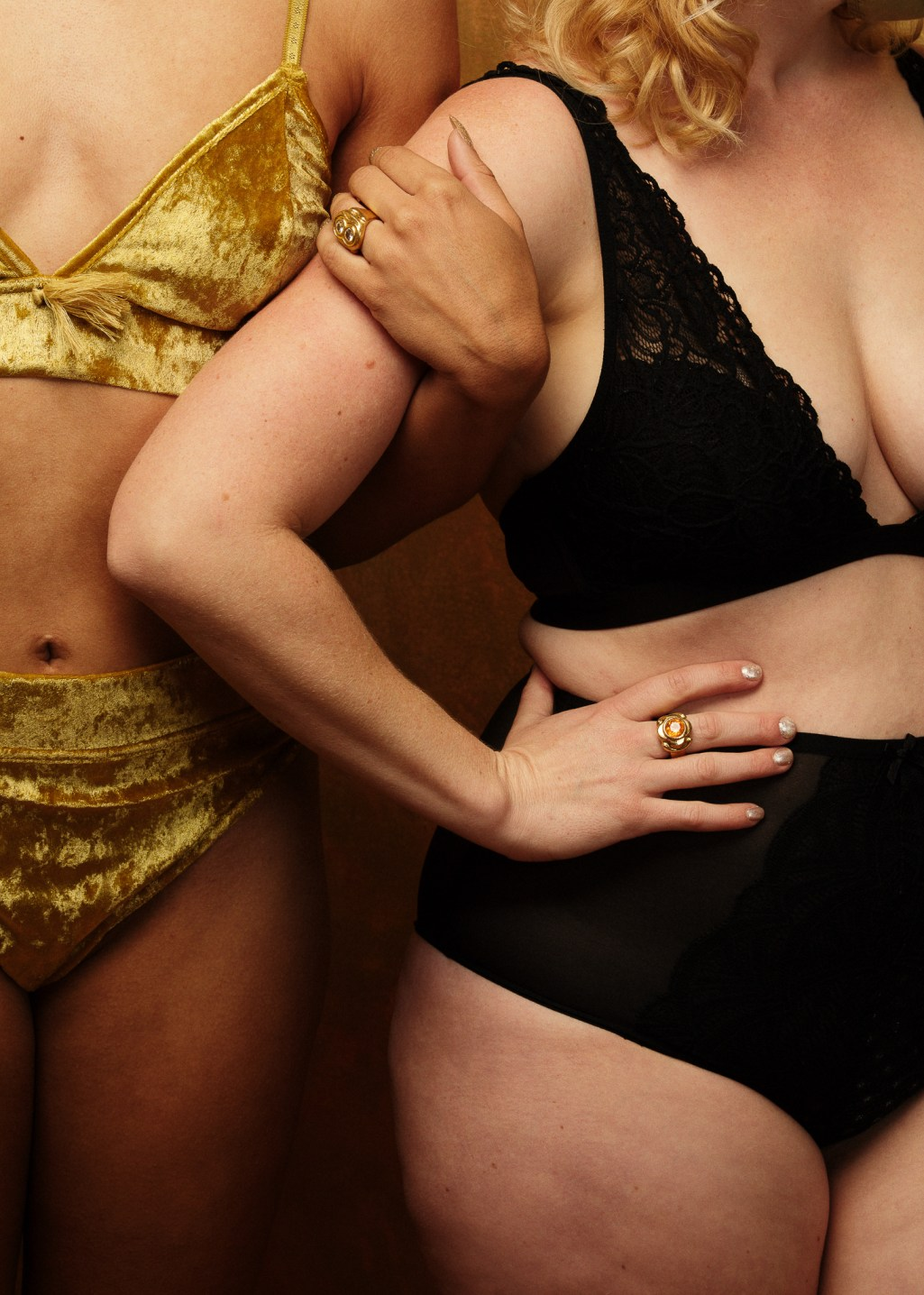 Body positive lingerie photography for women. By Oakland boudoir photographer Ella Sophie. Women with arms linked together.