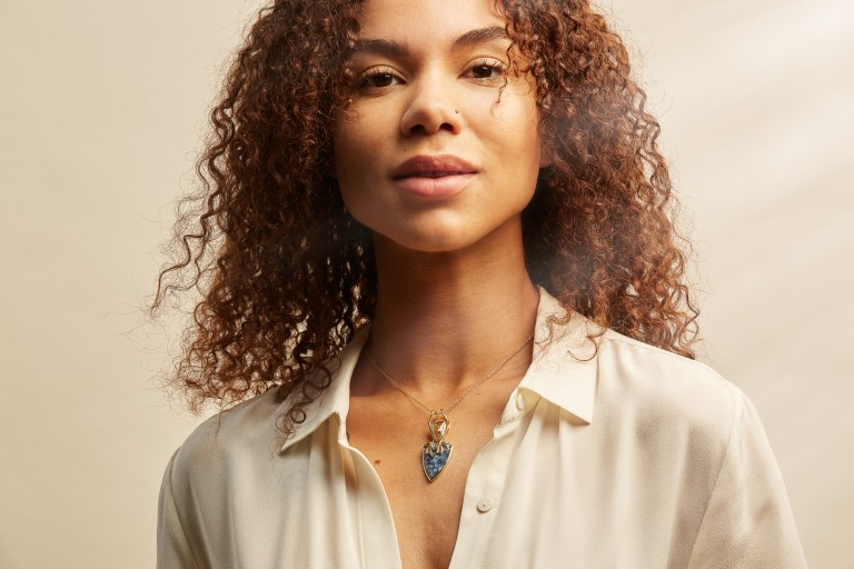 Empowered, confident, feminist jewelry advertising with black model wearing natural curly hair
