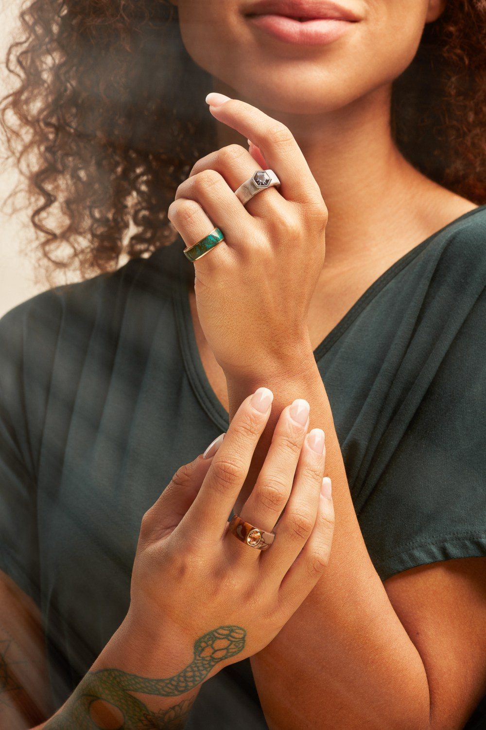 rings shown on models hands with dreamy soft lighting for Mercurius fine jewelry designers Oakland CA