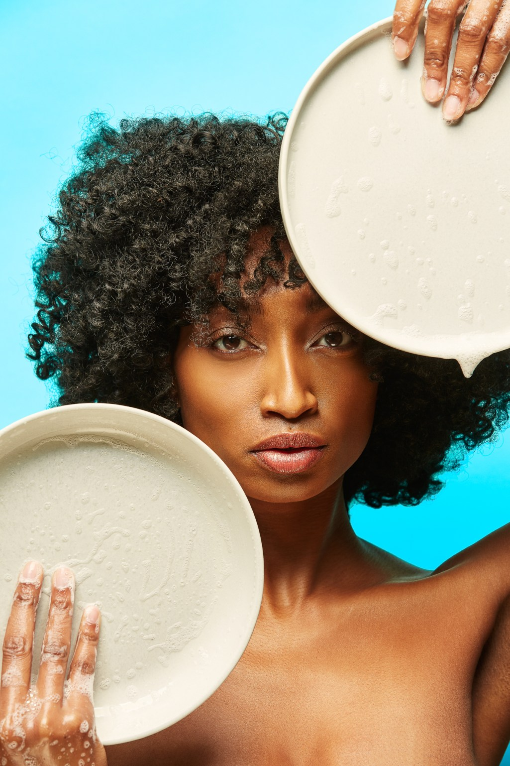 Conceptual portrait of model holding soapy dish by San Francisco photographer Ella Sophie