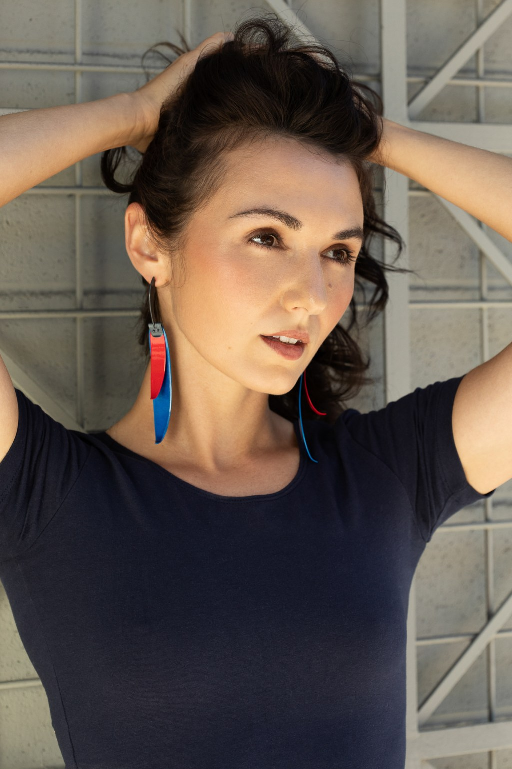 Lifestyle jewelry branding photography. Metal earrings worn by model Zoe West with makeup by Kalyn Slaughter