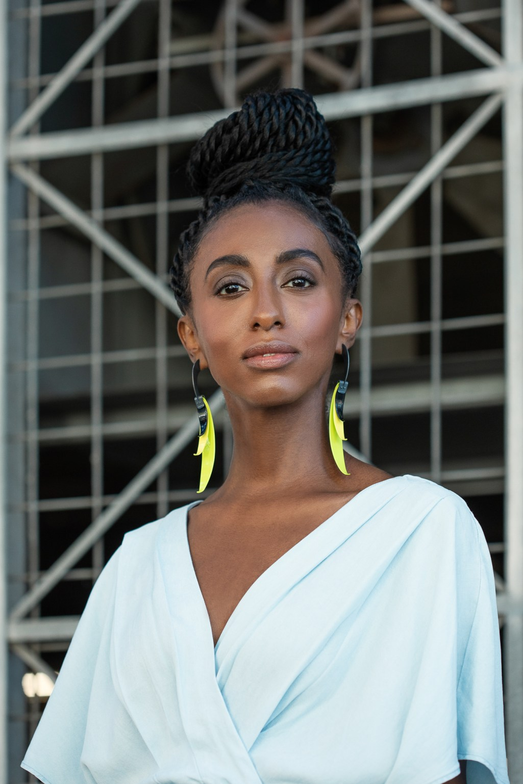 Powerful and bold photography of woman wearing yellow earrings.