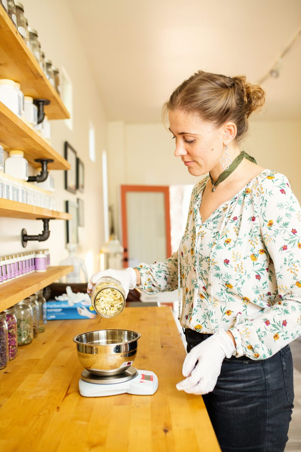 Marketing & Branding photography showing Dr. Clara Wetmore preparing Chinese herbal medicine in her Taos NM clinic. Photography byEllaSophie, Professional Commercial photographer for women owned businesses.