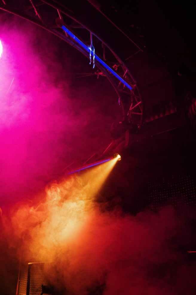 purple and orange light on a concert