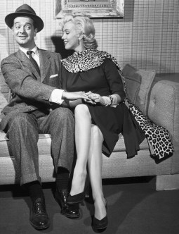 "28 Nov 1952 --- In 1953, the late Marilyn Monroe proved to be a masterful teacher as she taught newcomer Tommy Noonan how to make love in the movie ""Gentlemen Prefer Blondes."" Ten years later Noonan was starring in his own production of ""Promise Her Anything"" with another blonde sex goddess, Jayne Mansfield. The pictures speak for themselves about Tommy's struggles against designing women. --- Image by © Bettmann/CORBIS"