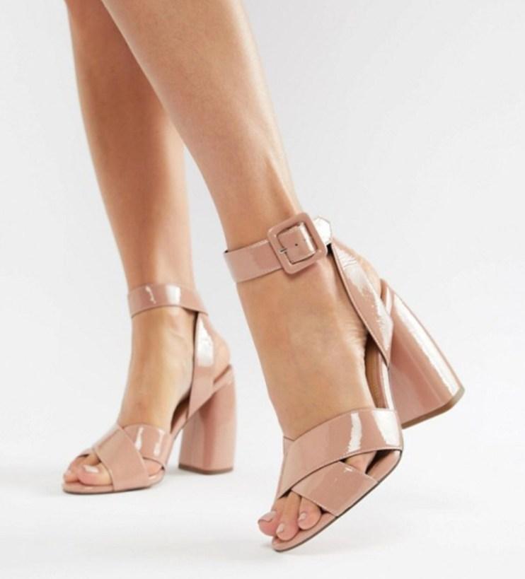 ASOS Design, Hedge Your Bets Block Heeled Sandals. Sizes UK 2 - 9. £40.00. https://www.asos.com/asos-design/asos-design-hedge-your-bets-block-heeled-sandals/prd/9859904?clr=warm-beige-patent&SearchQuery=asos+design+here+your+belts+block+heels&SearchRedirect=true