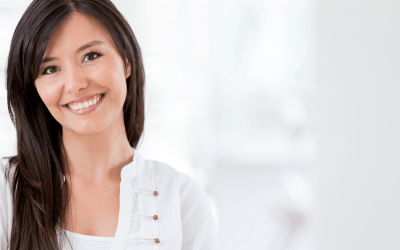 woman brunette with white shirt smiling