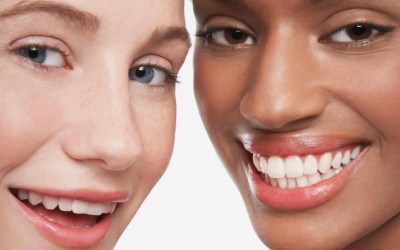 caucasion and african american woman smiling