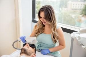 Atlanta esthetician performing laser facial treatment in Atlanta
