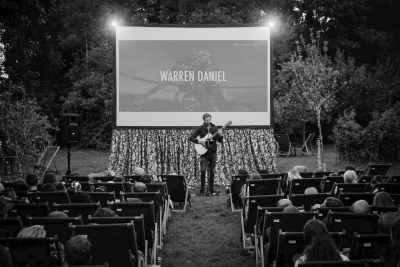 Gallery image of Warren Daniel back playing before Moonlight at Enchanted Cinema