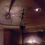 Migration, 15' H x 15' diameter, moving shadow, wheel with 48 objects, lenses, halogen light