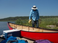 Cleaning out the boats before the portage.