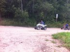 Idiots on All Terrain Vehicles, storming up and down the road, with no helmets on.