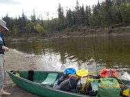 Cooking pails and other gear in the canoe on the Athabasca River