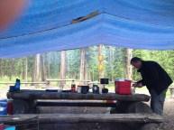 Group meal preparation in the rain, at Maligne Lake, Jasper NP