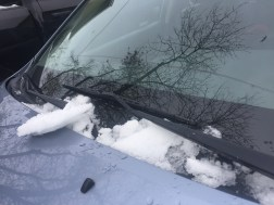 Windshield wipers will clear light snow and ice after the car warms up.