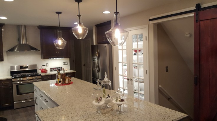 a 10-foot island and dishes on display - a kitchen remodel for the