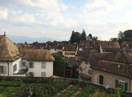 The Chateau d'Aubonne's rooftop vegetable garden, viewed from the ramparts, with the medieval town behind, then Lake Geneva and in the far distance, France.