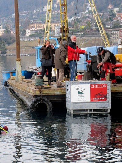 Wines from Chateau de Chillon and Badoux winery (which makes the Clos de Chillon for the chateau) are lowered into Lake Geneva 16 January 2014, where they will sit for months, possibly years