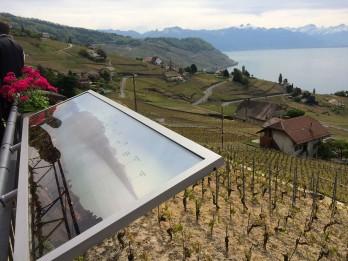 Panel on the veranda names the mountains across Lake Geneva