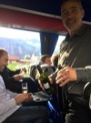 Sharing a glass on the bus en route to the national wine competition: Valais producers