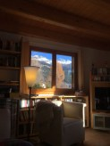 At home on the sofa, ice on the knee - and blue sky above snowy peaks!