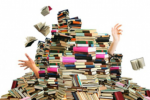 Image result for a computer buried in books pictures