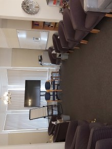 Training room on the ground floor of The Ellesmere Centre Holderness Road which is a large therapy training room suitable for groups. There are lots of chairs, a projector and white board.