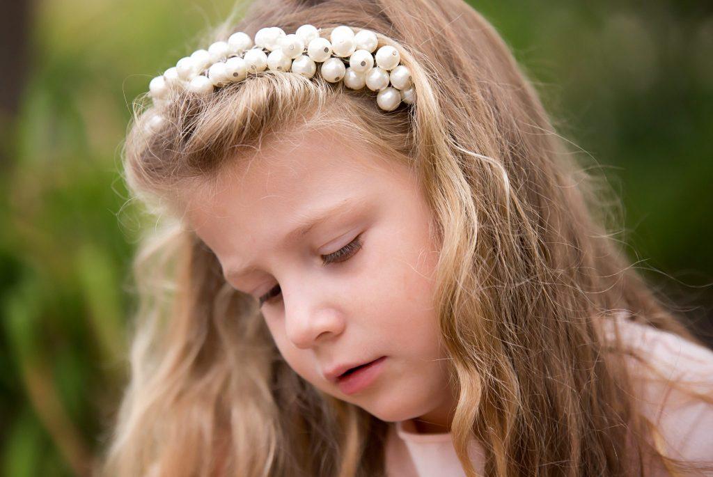Little girl looks at flowers