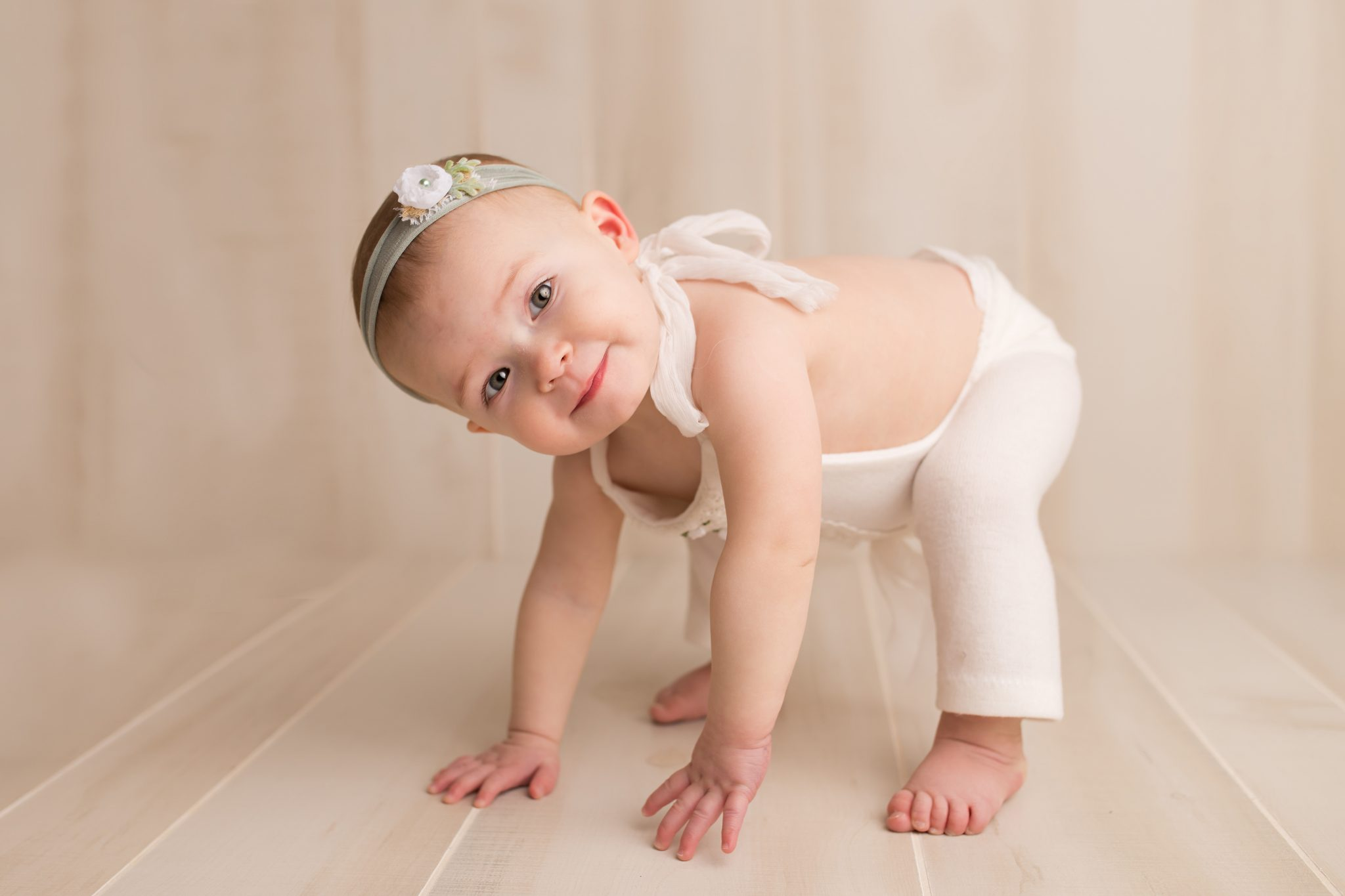 little girl crouching down in-studio session