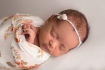 newborn baby girl in floral wrap