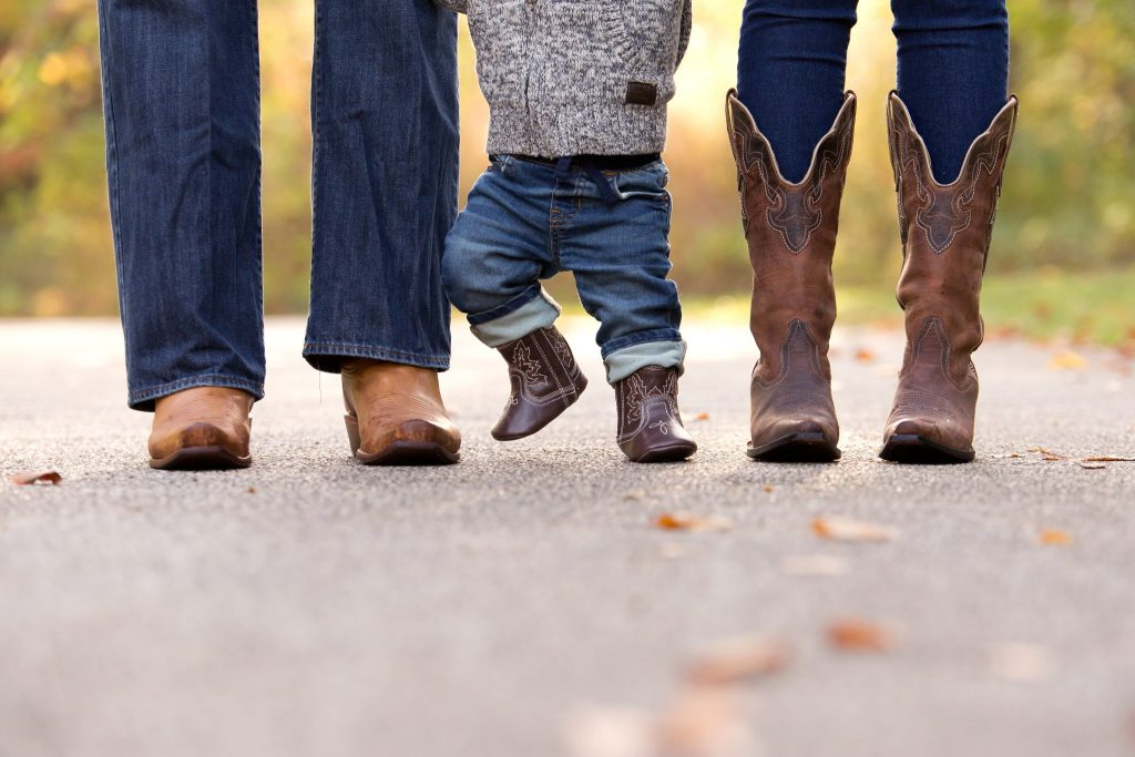photo of parents and baby boy's brown cowboy boots