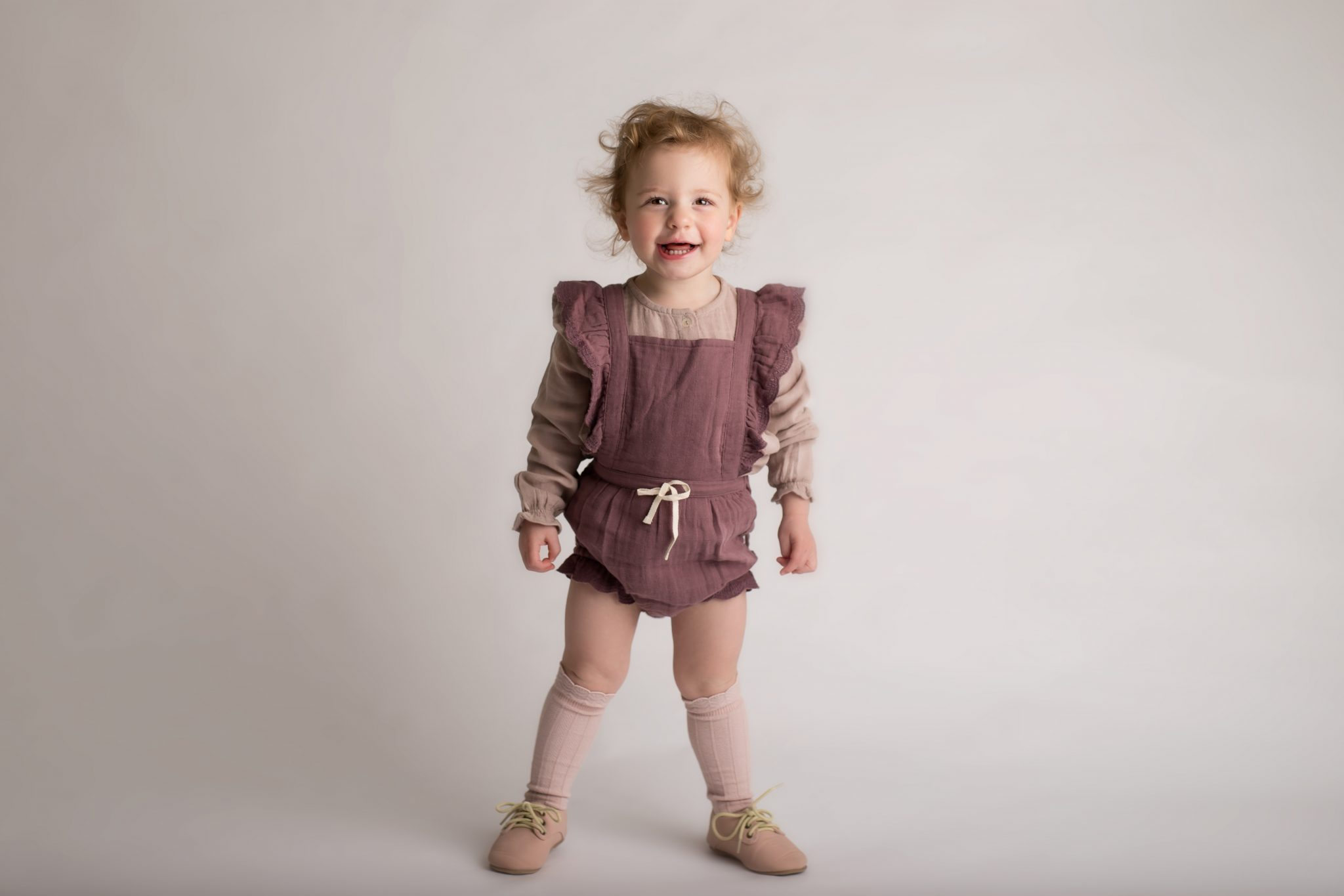 two year old girl in studio