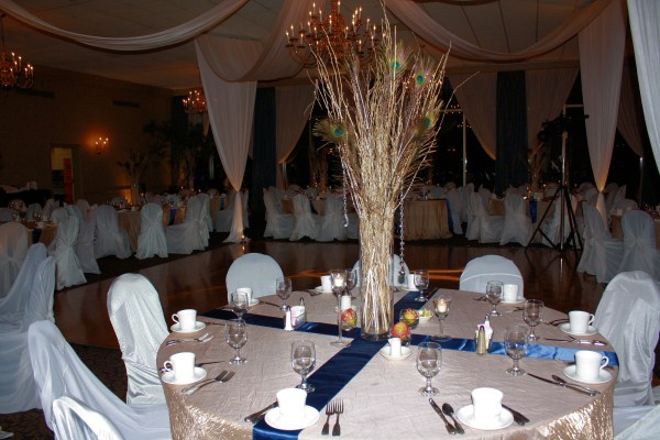 Tall Centerpiece with Branches and Peacock Feathers