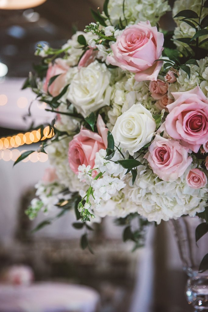 pink and white roses, greenery, centerpieces