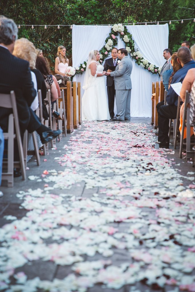 petal design, ceremony, bride and groom
