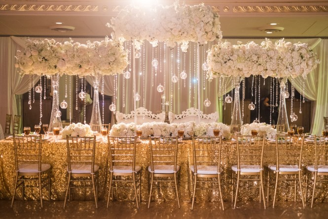 large centerpieces, gold and white decor