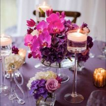 purple wedding centerpieces,candles, purple wedding