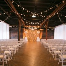 draped lights, centerpieces, ceremony