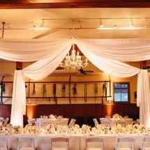 ceiling drape, chandelier, flowers