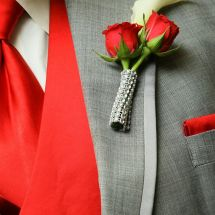 red bling boutonniere, suit and tie