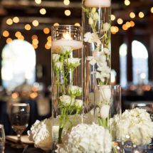 cylinder vases, flowers, candles