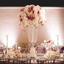 large centerpiece, orchids, roses, purple