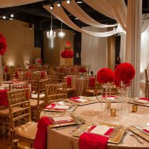 red floral design, ceiling drape, centerpieces
