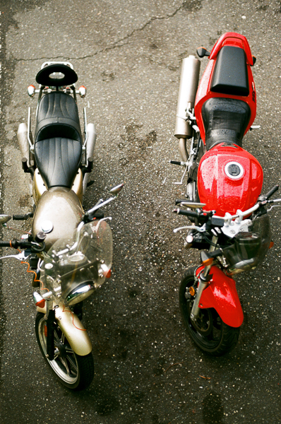 an overhead view of two parked motorcycles