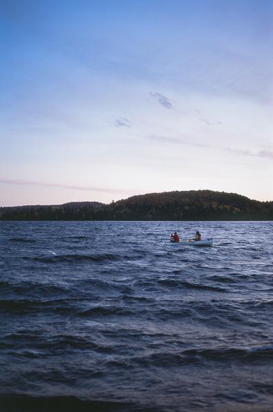 a canoe on a lake at dusk