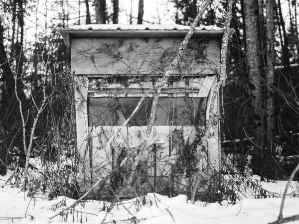 a black and white photo of a hunting shack in Maine