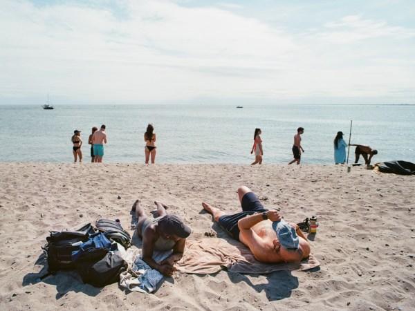 People sunning on the beaches on Toronto Island.