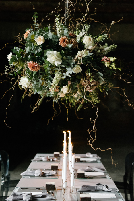 Wedding table with hanging flowers in the old factory venue in Thessaloniki